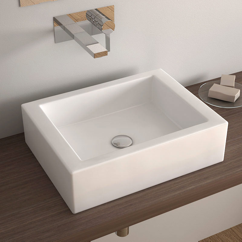 Une salle de bain est equipee dune vasque une salle de for Poser une vasque salle de bain